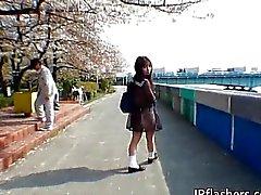 Asian schoolgirl enjoys outdoors