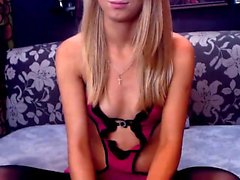 Sexy little blonde cutie smiles as she poses and her live w