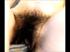 Horny Asian slut with a full bush rides huge dildos until s
