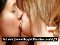 Naughty brunette and blonde lesbians kissing and fingering pussy and having lesbian sex