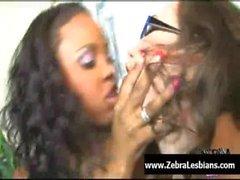 Zebra Girls - Ebony lesbian babes enjoy deep strap-on fuck 25