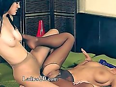 Hot girl4girl using big black strapon