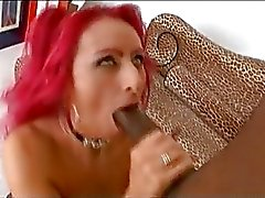 Red headed Raven Black fills her filthy mouth with a juicy cock and loves it