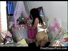 Petite Asian teen in diapers tries to please herself