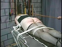Curvy blonde gets bound to operating table
