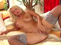 Blonde with big tits masturbates in high heels and thigh high stockings
