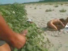 Italian lesbian couple fingering on the beach for voyeurs