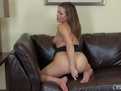 Ashlynn Leigh pleases her shaved slit every way she can on the couch