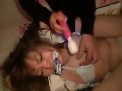 Luscious Oriental girl has two masked boys fulfilling her s
