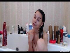 Skinny brunette in shower
