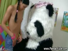 Toy panda loving teen enjoys a bit of plush action
