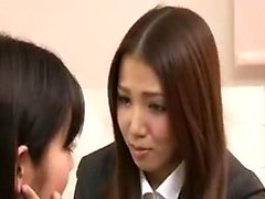 Two sexy Asian girls kiss each other and explore their lesb