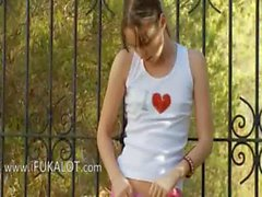 Skinny Ivana teenie playing in backyard