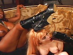 Blond slave has to please mistresses