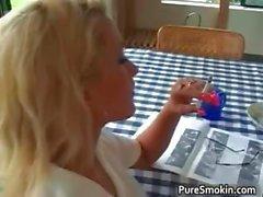 Gorgeous blonde hottie smokes cigarette part3