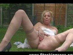 Busty Blonde Fucks Pussy in Garden