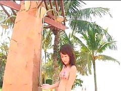 Busty Jap girl plays on the beach