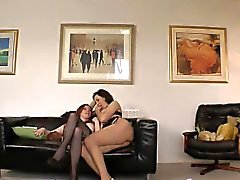 Mature lez plays with busty babe on spycam