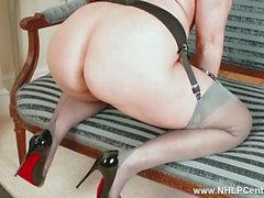 Curvy blonde masturbates in sexy grey nylons and high heels
