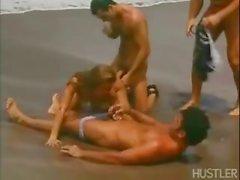 Rita gets three dicks on the beach