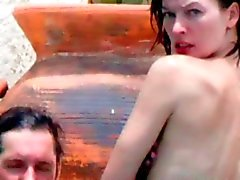 Milla Jovovich in the Pool with her Husband - Slideshow