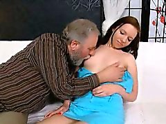 Getting down on her knees in front of her old man lover,