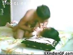 Slim Indian coed having sex inside the dorm