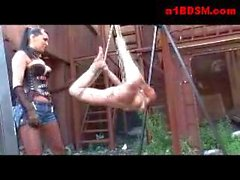Girl Hanging In Bondage Tortured With Clips By Mistress On The Junkyard