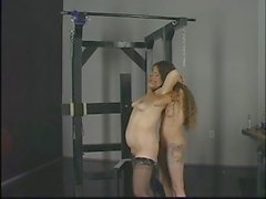 Horny brunette whips chubby blonde's fat ass