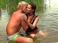 Young busty Rita suck and ride cock outdoors