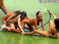 Five naked pornstars getting wet outside