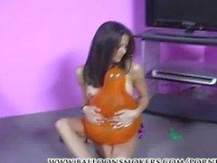 Looner teen blowing to pop balloons
