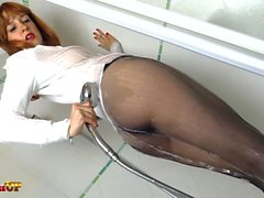 Redhead in Pantyhose masturbates in the shower