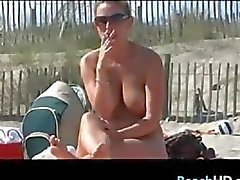 Busty Girl Smoking At The Beach