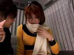Striking Japanese girl with a cute smile exposes her big na