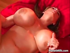 MILF with big tits gives her head