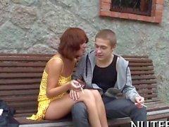 redhead lass is loving to smoke on a dudes cigar