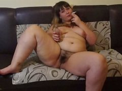 naked plump by a pussy hairy smokes
