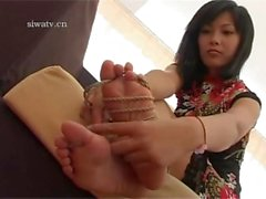 Kiinalaisen tytön sidottu jalat