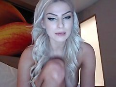 Blonde Jessi Gold in an erotic solo striptease video