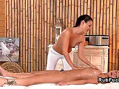 Brunette masseuse fingered by blonde