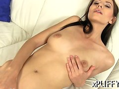 Lusty sweetheart is shoveling three candles into her slit