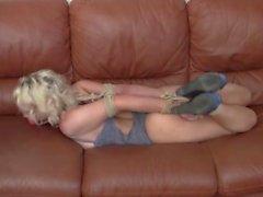 Blond teen hogtied on the sofa nicely ballgagged