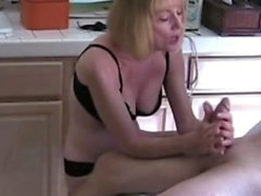 Sexy amateur mature blonde gives a great handjob at cum