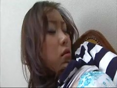Big titty babe Hitomi Aizawa toys her furry muff with a vib