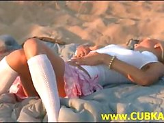 Hot blonde stripping on the beach
