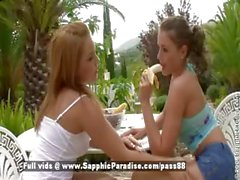 Zara and Salome blonde and redhead lesbian teens eating a banana and kissing