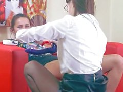 Two horny girls having sex on red bigbed
