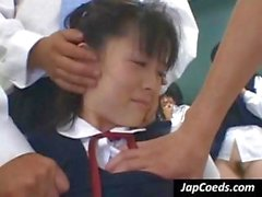 Naughty young Asian schoolgirls lift their skirts for a spanking from the teacher