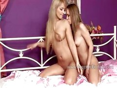 Beatrice and Lana kiss tenderly in bed